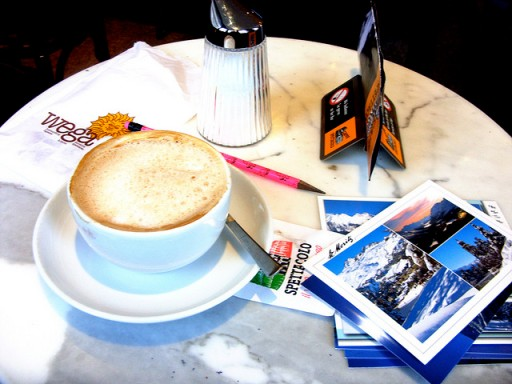 Writing postcards in a cafe in St. Moritz, Switzerland